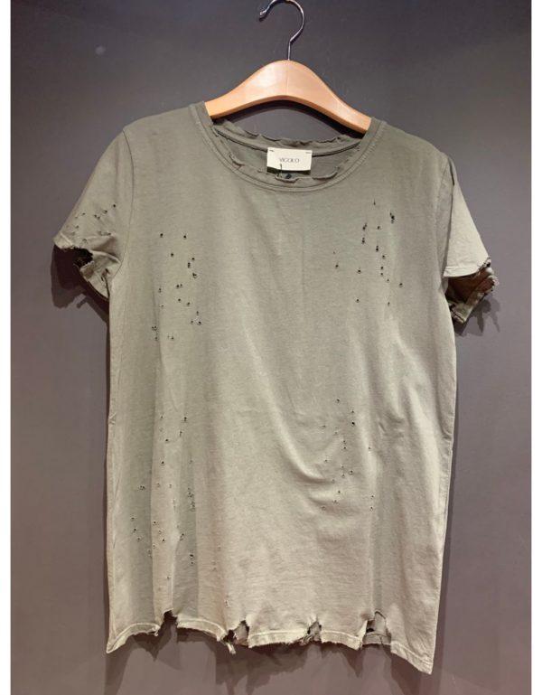 Samarreta foradada d'estil vintage. Disponible en blanc